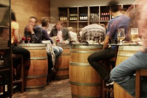 people sitting in a wine bar.