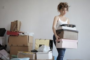 Woman packing boxes for moving to the East Village.