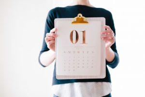 Woman holding a calendar.