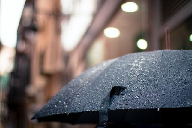 An open umbrella in the rain.
